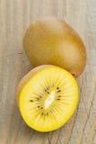 Golden kiwifruit/ kiwi cut and whole Royalty Free Stock Photos