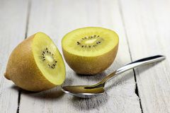 Golden kiwifruits. On wooden background Royalty Free Stock Image