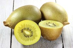 Golden kiwifruits. On wooden background Stock Photo