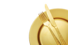 Golden knife and fork with plate Royalty Free Stock Photo