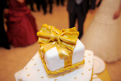 Golden Knot on Cake Stock Images