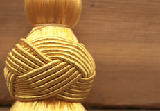Golden knot top tassel Royalty Free Stock Photography