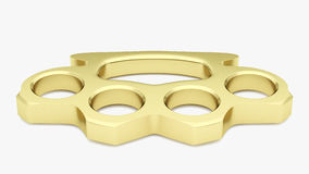 Golden Knuckle Duster. A shiny gold plated knuckle duster in a studio environment Royalty Free Stock Photography