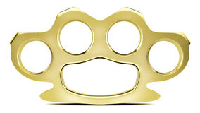 Golden Knuckle Duster. A shiny gold plated knuckle duster in a studio environment Royalty Free Stock Photo