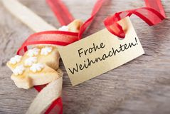 Golden label with Frohe Weihnachten. A golden label with the german words Frohe Weihnachten which means merry christmas stock photos