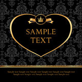 Golden label heart on damask black background Stock Photo
