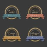 Golden labels with ribbons Stock Photography