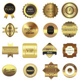 Golden labels set. Isolated on white background Stock Photos