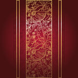 Golden lace ornament on deep red background. Royalty Free Stock Photos
