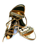 Golden ladies footwear Royalty Free Stock Images