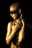 Golden lady. Young woman with golden skin Royalty Free Stock Photo