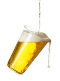 Golden lager or beer in disposable plastic cup. Golden beer, ale or lager in a tilting plastic disposable cup or glass with beer being poured and spilling over stock photos