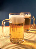 Golden lager beer drink in table Royalty Free Stock Photos