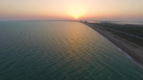 Golden lake surface at sunrise, aerial video. Water surface in golden glow of sunrise, aerial video stock video footage
