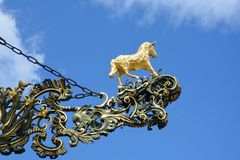 Golden lamb statue and sign Stock Photo