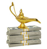 Golden lamp on bundle of money Royalty Free Stock Image
