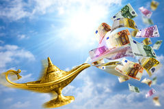 Golden lamp and money. Golden Aladdin lamp with money desire Stock Photography
