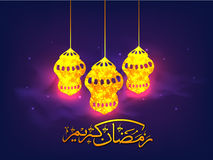 Golden Lamps with Arabic text for Ramadan Kareem. Beautiful Golden Lamps and Arabic Islamic Calligraphy of text Ramadan Kareem on shiny background for Holy Royalty Free Stock Image