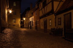 Golden lane inside the Prague Castle. Mysteriously looking medieval street at night Royalty Free Stock Images