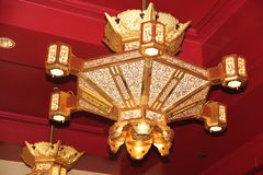 The Golden Lantern. This brightly lit golden lantern can be seen hanging down from the ceiling of the main prayer hall Stock Image