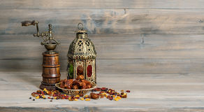 Golden lantern vintage mill. Oriental arabic decoration fruits royalty free stock photography