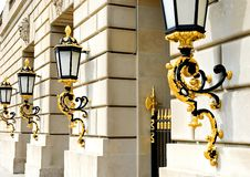 Golden Lanterns. Decorative gold lanterns on entrance to office building Royalty Free Stock Photo