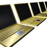 Golden laptops in row Royalty Free Stock Image