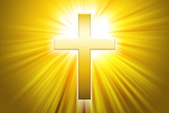 Golden latin cross with sunbeams Royalty Free Stock Photo