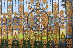Golden lattice of Catherine Palace against Catherine Palace, Tsa Royalty Free Stock Image