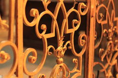 Golden lattice forged fence. Golden iron lattice gates decorative with leaves Royalty Free Stock Photo