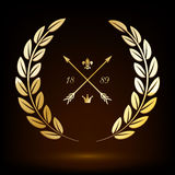 Golden laurel wreath with arrows, lily and crown. Stock Photography