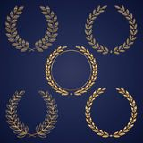 Golden laurel wreaths Stock Photos