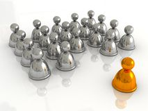 Golden leader figure standing in front of a group Stock Images