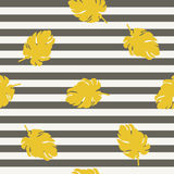 Golden leaf on striped background seamless pattern Stock Photo