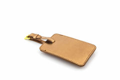 Golden leather luggage tag. Stock Photos