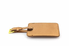 Golden leather luggage tag. Stock Image