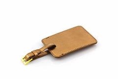 Golden leather luggage tag. Royalty Free Stock Images