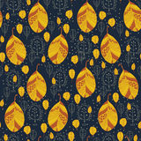Golden leaves on a dark blue background Royalty Free Stock Photos