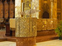 Golden Lectern inside catholic church Royalty Free Stock Image