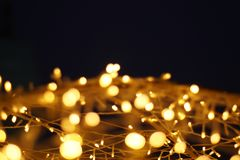 The golden LED light bokeh blurred abstract pattern background.  royalty free stock photo