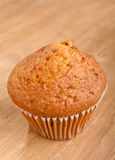 Golden Lemon Muffin on a Wooden Table Stock Photography
