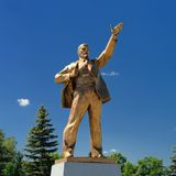 Golden Lenin monument in clear blue sky with fir trees in Zadons Royalty Free Stock Photos