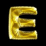 Golden letter E made of inflatable balloon isolated on black background. 3d rendering vector illustration
