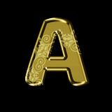 Golden letter A with floral ornament.Isolated on black. Stock Images