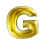 Golden letter G made of inflatable balloon isolated on white background. Stock Image