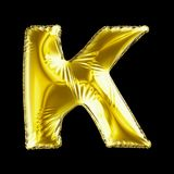 Golden letter K made of inflatable balloon isolated on black background. 3d rendering royalty free illustration