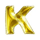 Golden letter K made of inflatable balloon isolated on white background. 3d rendering vector illustration