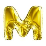 Golden letter M made of inflatable balloon isolated on white background. 3d rendering Stock Images