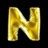 Golden letter N made of inflatable balloon isolated on black background. 3d rendering stock illustration