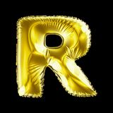Golden letter R made of inflatable balloon isolated on black background. 3d rendering royalty free illustration
